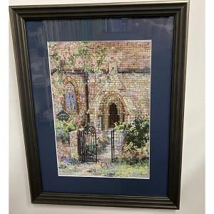 framed cross stitch church gate